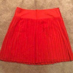 Orange pleated work skirt
